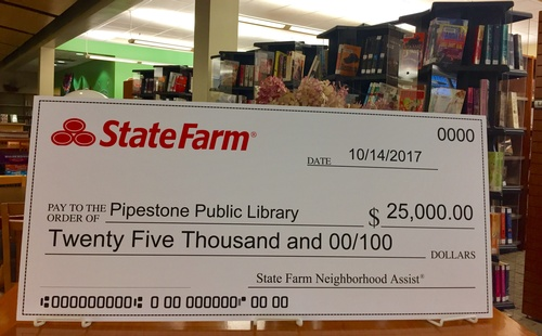 Michelle Cheeseman State Farm Agency $25,000 Check to Meinders Community Library