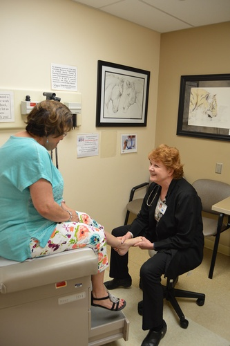 Our nurse practitioner talks with a patient in the medical clinic.