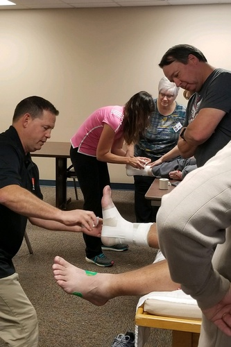 Many classes are provided to the community, such as this taping class for local teachers and coaches.