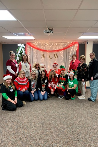 Staff pose at Holiday Open House.