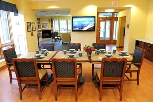 Open dining room and living areas with safe and separate entrance and parking at The Willensky Residence, An Assisted Living Memory Care Community at Montefiore
