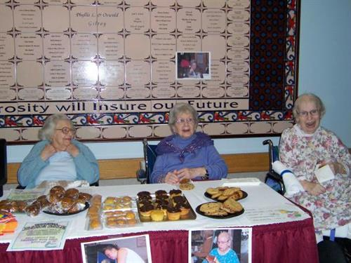 Gallery Image Getting into the spirit of a worthy cause Madeline Fleischman (right) calls out for customers as Rhea Silver and Goldie Kaplan prepare for bake sale business.JPG