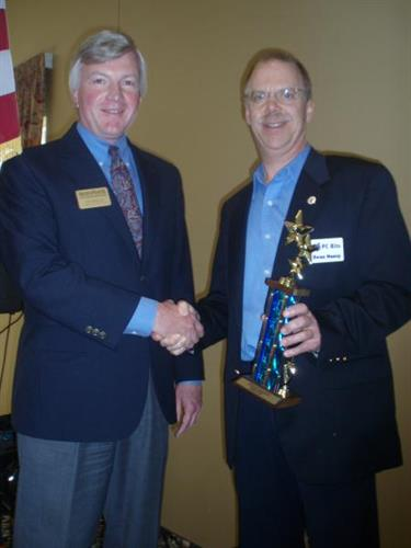 2010 Board Chair, Tom Newland with Micro Business of the Year winner Dean Hancy of PC Bits