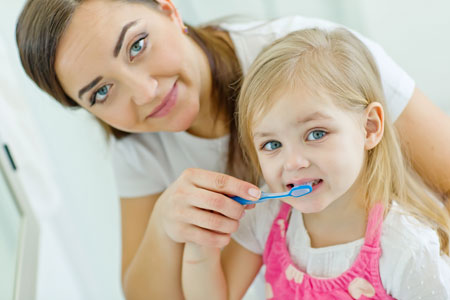Gallery Image mom-daughter-brushing-teeth.jpg
