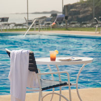 Our seasonal outoor, Olympic-sized swimming pool. We also offer an indoor heated pool.