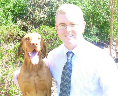 Dr. Michael J. Watts, owner (with his dog, Otis)