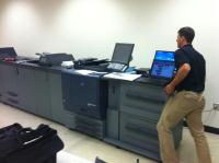 Tri-Copy senior technician installing Production Color Copier/Printer