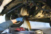Gallery Image Express-Oil-Change-Franchise-Changing-Oil.jpg