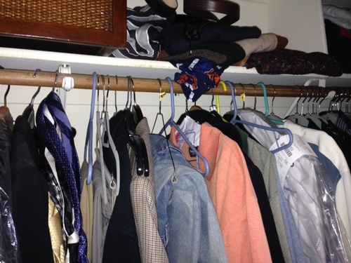Messy men's closet Before Room Solutions By Paula