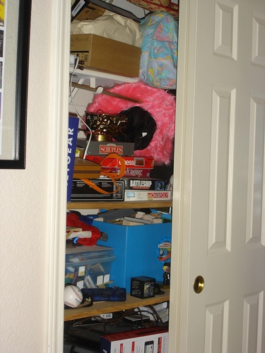 Messy game closet Before Room Solutions By Paula