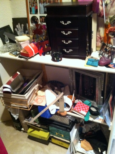Cluttered closet built-in Before Room Solutions By Paula