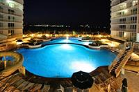 Dramatic Island lit nights around the pool overlooking the Gulf Coast