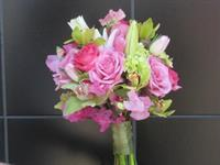 Hot pink and lavender roses, green hydrangea, sweet peas, green cymbidium orchids and lilies...a beautiful bouquet