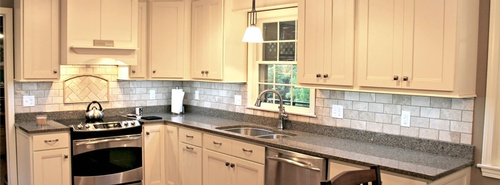 Soft white cabinets and gray counter tops feel modern but not stark