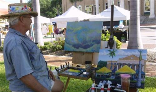 Local Artist Charles Peck painting at farmer's market