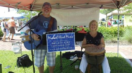 Local Musician Michael Hirst performing at farmer's market