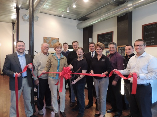 Nomdic Ribbon cutting for grand opening of business