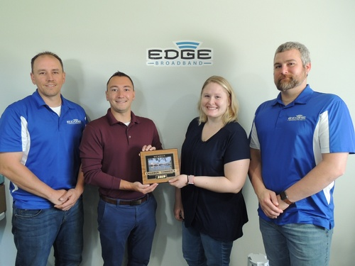 Edge Broadband joins Fort Atkinson Chamber! (From left to right: Brian Madl, Owner; Chris Scherer, Board Member; Ashley King, Office Manager; Ramsey Cain, Network Administrator)