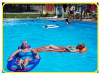 sitting by the pool or enjoying a cool dip at KOA's pool