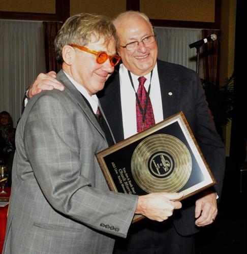 George Di Ciero presenting Rock Star Award to Chuck Morris.