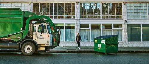 Gallery Image smb-truck-man-dumpster.jpg