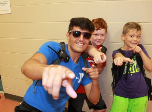 Gallery Image Saponi-campers-and-counselor-posing-and-pointing-at-the-camera-610x450.jpg