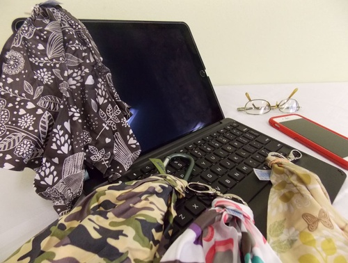 The convenient clip attaches to your purse or bag.  Camo print features a carabiner clip.