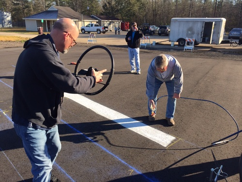 Mayor Craig McGeHee along with ''Heart & Sole'' team helps paint the helipad.