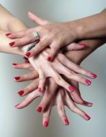 Gallery Image 2_sets_of_hands_with_red_and_pink_nails.jpg