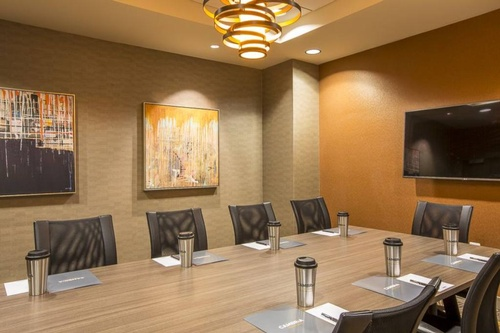 "Enjoy the smart meeting in our Gleason Boardroom, equipped with a 72"" Smart TV"
