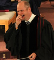 Pastor Craig tells a joke during worship