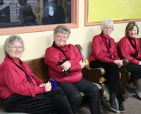 Bell Choir members relax between services