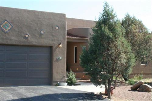 Santa Fe style home finished with synthetic stucco and custom inset spanish