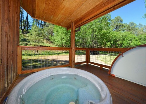 Outdoor Hot Tub at Riverside Cabin