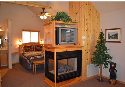 Cabin interior with Knotty Pine and 2 sided Gas Fireplace