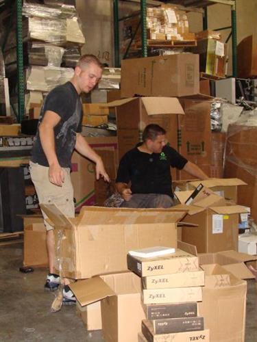 Gallery Image Cameron%20and%20Jason%20organizing.JPG