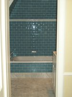Glass Tub Walls with Marble Bath Floor