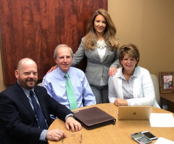 Energy Alliances offers low-cost energy prices. From left to right are Mark Bishop, (vice president), Bill Grafe, (president), Sydney Faxon Trout, (CEO) and Cathy Deters, (sales director).