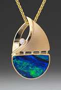 Swamp John's 14k gold and opal sailboat pendant