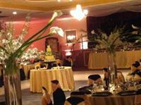 Wedding In Black Chair Covers w/ Yellow Sash & Pink Uplighting