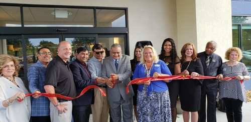 Gallery Image Ribbon%20cutting%20home%202%20suites.jpg