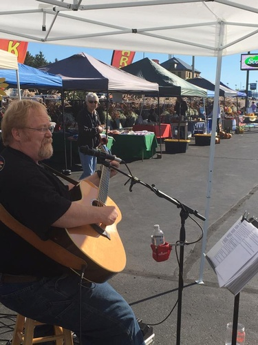 Kirk Brock playing live at the Farmers' Market on 9/10/16.
