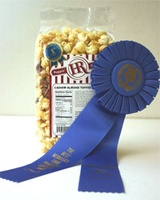 HR Poppin' Snacks received the Blue Ribbon for their exclusive Cashew Almond Toffee.  The ribbon was awarded at the Best Nebraska Food Products Contest in the Candy and Nuts division.