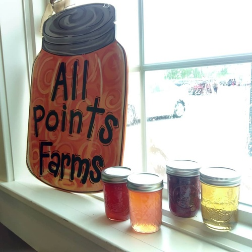 The All Points Farms sign