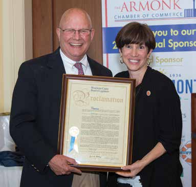 Last Year's Citizen of the Year, Ed Woodyard, accepting his Proclamation from County Legislator Margaret Cunzio