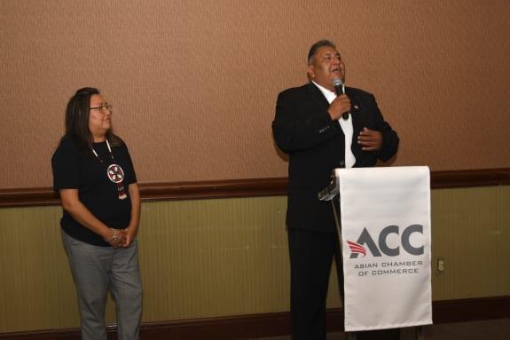 Yolanda-and-Clint-Poncho-at-podium.JPG-w575.jpg
