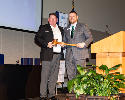 Jayce Stepp, 2019 Board Chair, passes the official gavel on to Josh Brock, 2020 Board Chair.