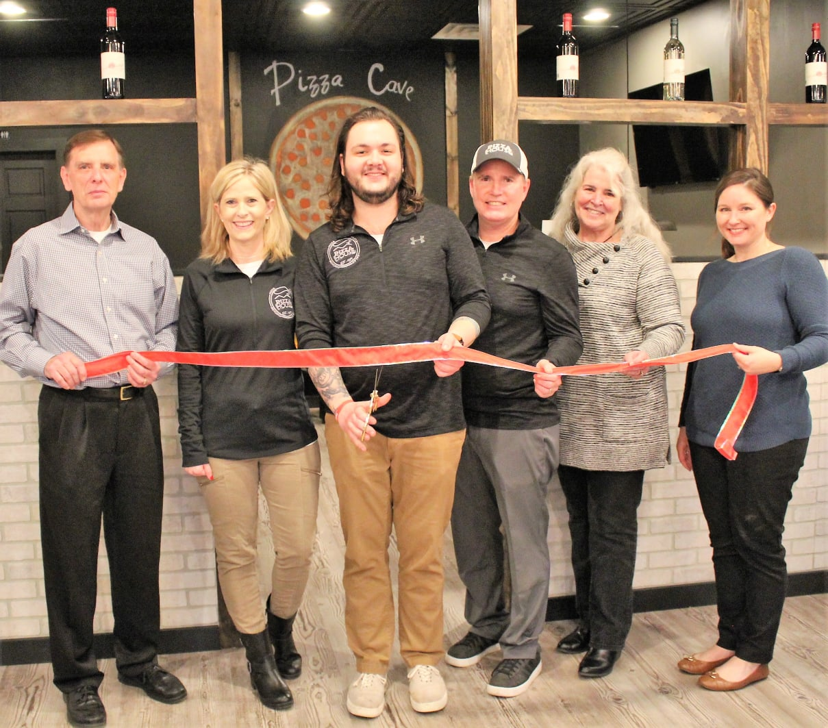 Members of the Northern Hamilton County Chamber of Commerce hosted a special ribbon cutting to celebrate the grand re-opening of Pizza House as it enters its 27th year in operation.  Pictured (l-r):  Dan Strong (Town of Cicero/NHCCC), Karmen Little (Pizza House), Tayler Millbank (Pizza House), Steve Little (Pizza House), Liz Foley (NHCCC) and Samantha Miller (NHCCC).
