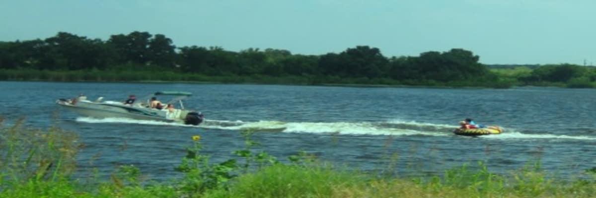 Boat-pulling-tube-at-lake-w1200.jpg