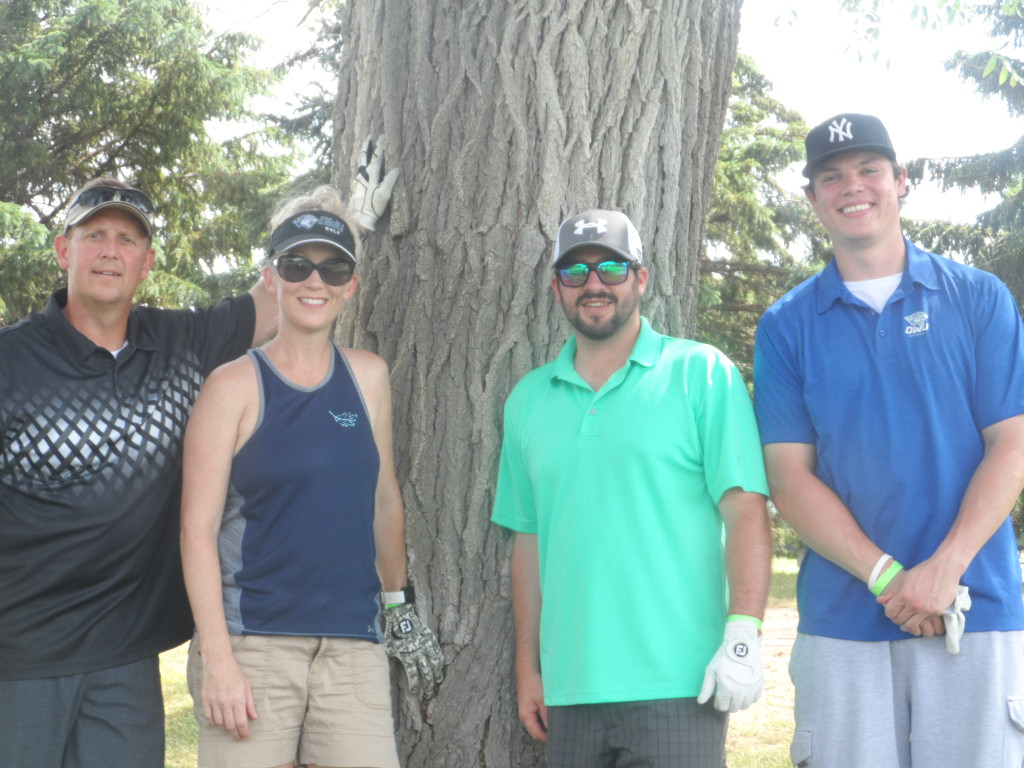 Jared Neilan, far right, with golf partners at Wild Oak Golf Course in Mitchell, SD.
